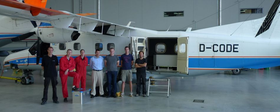 APEX team in front of aircraft